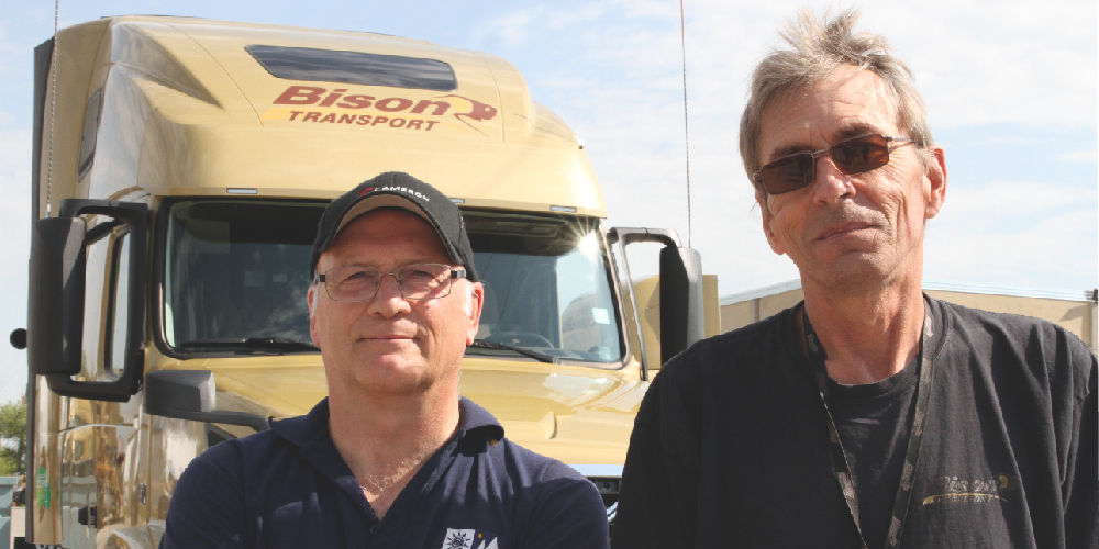 Bison drivers standing in front of truck