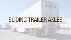 A truck driver sliding trailer axles