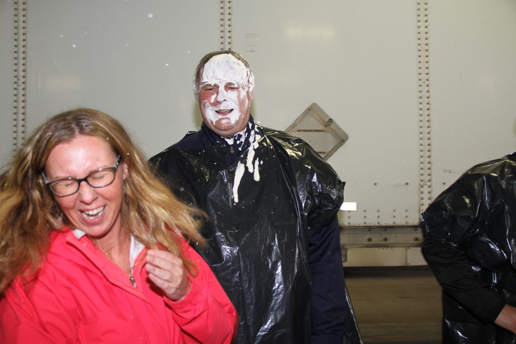 Employee throwing pie at managers face