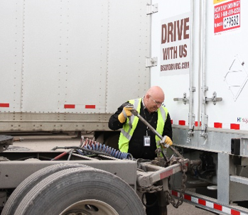 Driver hooking up LCV converter to semi trailer