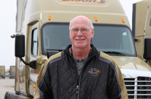 Truck driver standing in front of Bison Transport truck