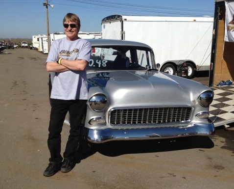 Randy Kuryk in front of drag racing car