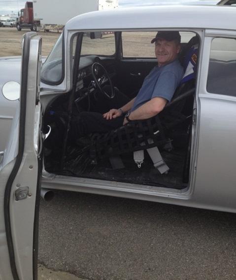 Randy Kuryk sitting in drag racing car