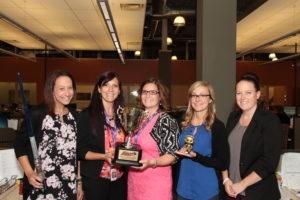 The HR Team accepts their 4DX Award.
