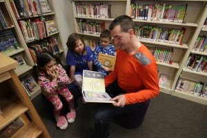 Bison team member JF reads with students at Brooklands School.